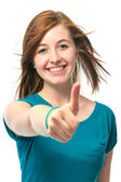 Female teenager shows a thumbs up — Stock Photo