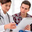 Doctor with male patient — Stock Photo #12335117
