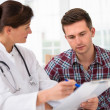 Stock Photo: Doctor with male patient