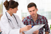 Doctor with male patient — Stock Photo