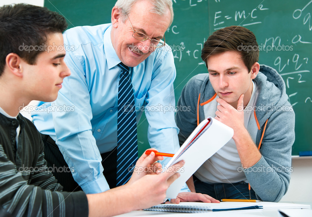 Male students with a teacher in classroom — Stock Photo #12365444