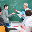 Teacher with students in classroom — Stock Photo #12386793