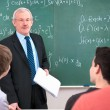 Teacher with students in classroom — Stock Photo #12386813