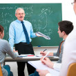 Teacher with students in classroom — Stock Photo #12386855
