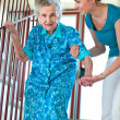 Royalty-Free Stock Photo: Climbing stairs with caregiver