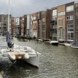Stock Photo: Sailboat and modern houses, amsterdam