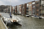 Sailboat and modern houses, amsterdam — Stock Photo