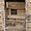 Scruffy wooden door, pigna — Stock Photo