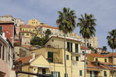 Old houses and palms, imperia — Stock Photo