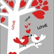 Two birds sitting at the brunch of the love tree. — Stockvector