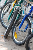 Wheels of children's bicycles — Stock Photo