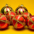 Christmas balls on yellow background — Stockfoto