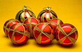 Christmas balls on yellow background — Stock Photo