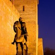 Sculpture of a knight before the castle in Gyula at twilight — Stock Photo