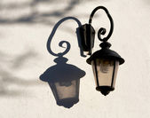 Old street lamp with modern electric bulb — Stock Photo