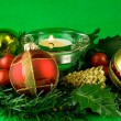 Christmas ornaments on green background — Stock Photo #10968393