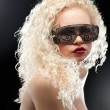 Royalty-Free Stock Photo: Party girl in club glasses