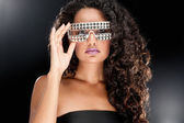 Party girl in club glasses — Stock Photo
