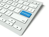 Keyboard and blue Strategy button, business concept — Stok fotoğraf