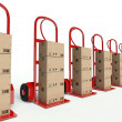 Row of hand trucks with cardboard boxes — Stock Photo
