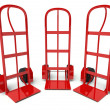 Three warehouse empty hand trucks isolated on white — Stock Photo #11480919