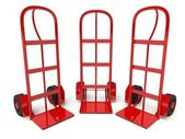 Three warehouse empty hand trucks isolated on white — Stock Photo