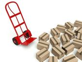 Warehouse empty hand truck and many cardboard boxes — Stock Photo