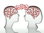 Man and woman heads profiles with connected brains, concept of communication — Stock Photo