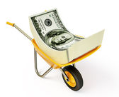 Money in wheelbarrow — Stock Photo