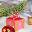 Christmas ball and gifts — Stok fotoğraf