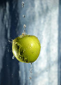 Green apple with drop of water — Stock Photo