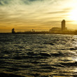 Sundown seascape with Barcelona on the background — Stock Photo #11279860