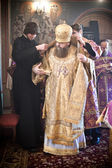 Two monks help the Bishop to robe — Stock Photo