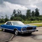 Blue American retro sedan at the parking — Stock Photo #11512688