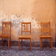 Vintage chairs near old wall — Stock Photo