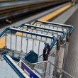 Luggage trolleys in railway station — Stock Photo