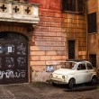 Stock Photo: White retro car in italian yard
