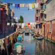 Gondolas in Venice street - Stock Photo
