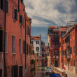 Venice canal with gondolas - Foto Stock