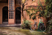 Bicycle under the wall — Stock Photo