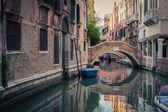 Venice canal with gondolas — Stock Photo