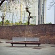 Bench in front of the wall - Stock Photo