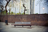 Bench in front of the wall — Stock Photo