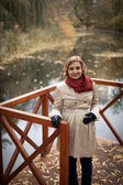 Woman near autumn lake — Stock Photo
