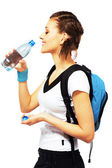 Happy sporty woman is drinking a fresh water — Stock Photo