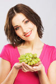 Lovely woman with fresh grapes — Stock Photo