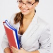 Lovely young businesswoman with folders and documents — Stock Photo