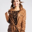 Cute young woman wearing leather jacket — Stock Photo