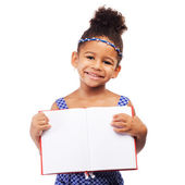 Lovely little girl with a notebook — Stock Photo