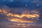 Clouds in a golden sunset — Stock Photo